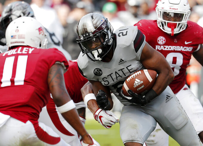 Mississippi State running back Nick Gibson (21) rushes for a first down against Arkansas during the first half of an NCAA college football game in Starkville, Miss., Saturday, Nov. 17, 2018. (AP Photo/Rogelio V. Solis)