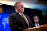 FILE - In this June 10, 2020, file photo, U.S. Secretary of State Mike Pompeo speaks during a news conference at the State Department in Washington. From Tokyo to Brussels, political leaders have swiftly decried Beijing's move to impose a tough national security law on Hong Kong that cracks down on subversive activity and protest in the semi-autonomous territory. But the rhetoric from democratic nations has more bark than bite. (AP Photo/Andrew Harnik, Pool, File)