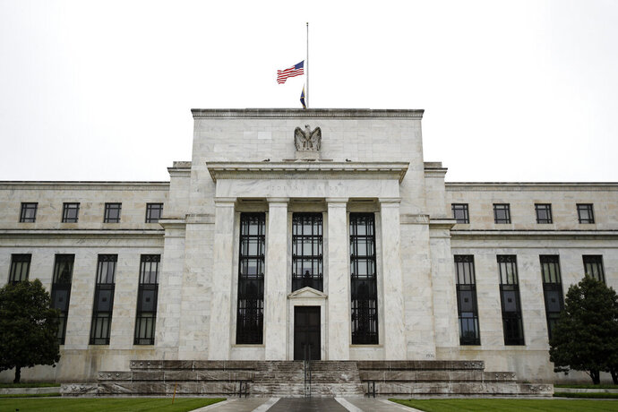 "This May 22, 2020 photo shows the Federal Reserve building in Washington. The Federal Reserve said Monday, June 15, 2020 that it will begin purchasing corporate bonds as part of a previously-announced program to ensure companies can borrow through the bond market during the pandemic The program will purchase already-issued bonds on the open market and will seek to build a ""broad and diversified"" portfolio that will mimic a bond-market index. (AP Photo/Patrick Semansky)"