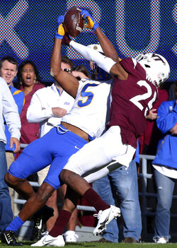 Pittsburgh's Jared Wayne (5) catches a pass from quarterback Kenny Pickett in front of Virginia Tech's Jermaine Waller (25) in the first half of an NCAA college football game, Saturday, Oct. 16, 2021, in Blacksburg, Va. (Matt Gentry/The Roanoke Times via AP)