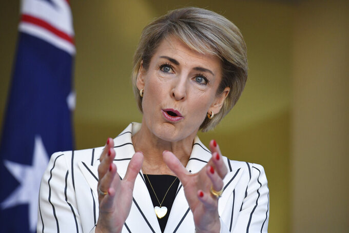 Australia's Attorney-General Michaelia Cash speaks at a press conference at Parliament House in Canberra, April 8, 2021. Cash said Wednesday, May 12, 2021, that her government had never been more determined to keep Australians free and safe from foreign interference after Chinese-born political adviser John Shi Sheng Zhang lost his challenge in Australia's highest court against laws banning covert foreign interference in domestic politics. (Mick Tsikas/AAP Image via AP)