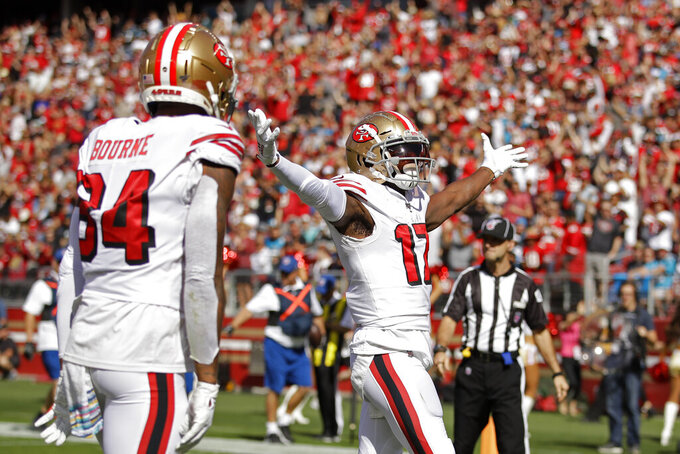 San Francisco 49ers wide receiver Emmanuel Sanders celebrates after scoring a touchdown as wide receiver Kendrick Bourne looks on during the first half of an NFL football game against the Carolina Panthers in Santa Clara, Calif., Sunday, Oct. 27, 2019. (AP Photo/Ben Margot)