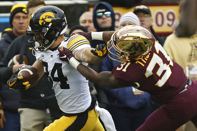 Iowa wide receiver Nick Easley holds off Minnesota's defensive back Kiondre Thomas during an NCAA college football game Saturday, Oct. 6, 2018, in Minneapolis. Iowa won 48-31. (AP Photo/Stacy Bengs)
