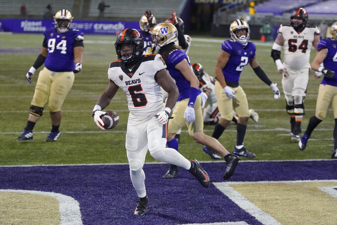 Oregon State running back Jermar Jefferson (6) scores a touchdown against Washington during the first half of an NCAA college football game, Saturday, Nov. 14, 2020, in Seattle. (AP Photo/Ted S. Warren)