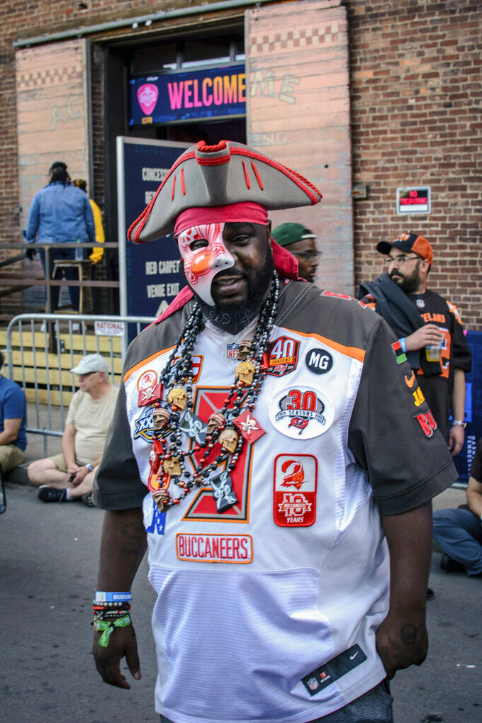 Tampa native and Buccaneer fan Jamal Sanders supports his team during the NFL Draft, Friday, April 26, 2019 in Nashville, Tenn. While it isn't unusual for fans who cheer for the same teams to bond at the NFL Draft, several super fans in Nashville for Friday's second and third rounds have enjoyed getting to know fans of teams they will be rooting against when the season kicks off in the fall. (AP Photo/Jim Diamond)