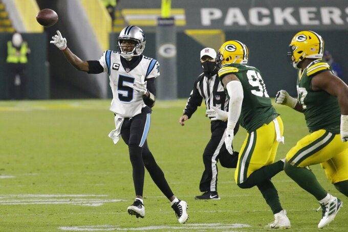 Carolina Panthers' Teddy Bridgewater throws a pass during the second half of an NFL football game against the Green Bay Packers Saturday, Dec. 19, 2020, in Green Bay, Wis. (AP Photo/Mike Roemer)