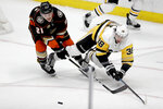 Anaheim Ducks defenseman Jake Dotchin, left, vies for the puck with Pittsburgh Penguins center Derek Grant during the second period of an NHL hockey game in Anaheim, Calif., Friday, Jan. 11, 2019. (AP Photo/Chris Carlson)