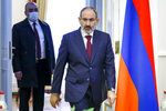 In this photo released by Russian Foreign Ministry Press Service, Armenia's Prime Minister Nikol Pashinian enters a hall for a meeting with Russian Foreign Minister Sergey Lavrov in Yerevan, Armenia, Saturday, Nov. 21, 2020. (Russian Foreign Ministry Press Service via AP)