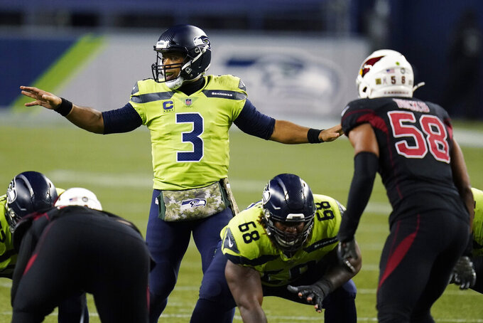 Seattle Seahawks quarterback Russell Wilson (3) gestures from the line of scrimmage during the second half of an NFL football game against the Arizona Cardinals, Thursday, Nov. 19, 2020, in Seattle. (AP Photo/Elaine Thompson)