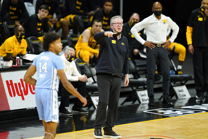 Iowa head coach Fran McCaffery directs his team during the first half of an NCAA college basketball game against North Carolina, Tuesday, Dec. 8, 2020, in Iowa City, Iowa. (AP Photo/Charlie Neibergall)