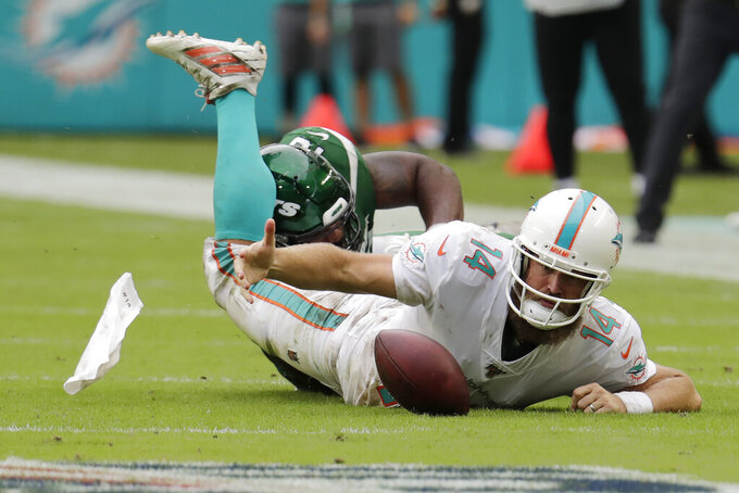 New York Jets outside linebacker Jordan Jenkins, back, sacks Miami Dolphins quarterback Ryan Fitzpatrick (14) during the second half of an NFL football game, Sunday, Nov. 3, 2019, in Miami Gardens, Fla. (AP Photo/Lynne Sladky)