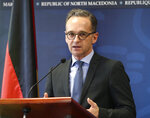 German Foreign Minister Heiko Maas answers a journalist's question during a news conference with his North Macedonia's counterpart Nikola Dimitrov, after their meeting in Skopje, North Macedonia, on Wednesday, Nov. 13, 2019. Maas arrived Wednesday in Skopje to discuss with his counterpart Nikola Dimitrov the bilateral relations and the further steps after North Macedonia has failed to open the membership talks with European Union last month. (AP Photo/Boris Grdanoski)