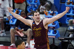Loyola Chicago center Cameron Krutwig (25) reacts to a basket against the Illinois during the second half of a men's college basketball game in the second round of the NCAA tournament at Bankers Life Fieldhouse in Indianapolis, Sunday, March 21, 2021. (AP Photo/Paul Sancya)