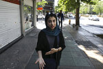 In this Friday, May 17, 2019 photo, civil servant and student Afra Hamedzadeh speaks during an interview in downtown Tehran, Iran.