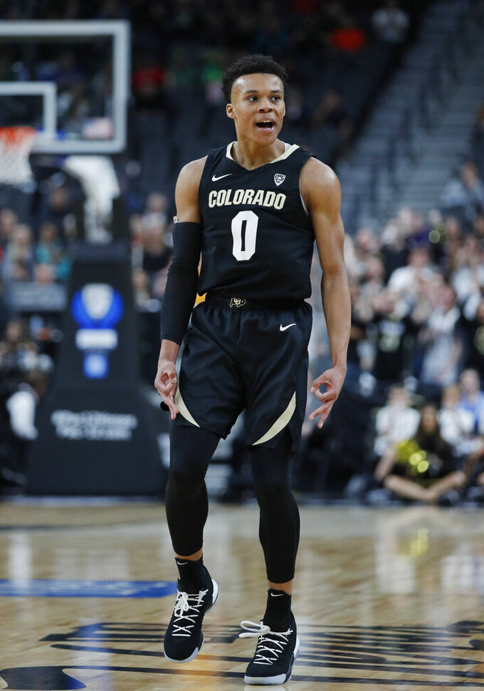 Colorado's Shane Gatling celebrates after making a three-point basket against Oregon State during the first half of an NCAA college basketball game in the quarterfinal round of the Pac-12 men's tournament Thursday, March 14, 2019, in Las Vegas. (AP Photo/John Locher)