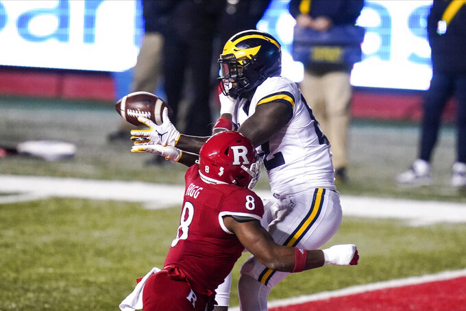 Michigan's Nick Eubanks catches a pass for a touchdown in front of Rutgers' Tyshon Fogg during the second half of an NCAA college football game Saturday, Nov. 21, 2020, in Piscataway, N.J. Michigan won 48-42 in three overtimes. (AP Photo/Frank Franklin II)