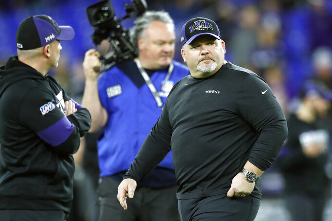 FILE - In this Jan. 11, 2020, file photo, Baltimore Ravens offensive coordinator Greg Roman looks on prior to an NFL divisional playoff football game against the Tennessee Titans, in Baltimore. Roman is tweaking and refining a record-setting unit led by NFL MVP Lamar Jackson, who is expected to again be the key component of an attack with several newcomers in the mix.(AP Photo/Julio Cortez, File)
