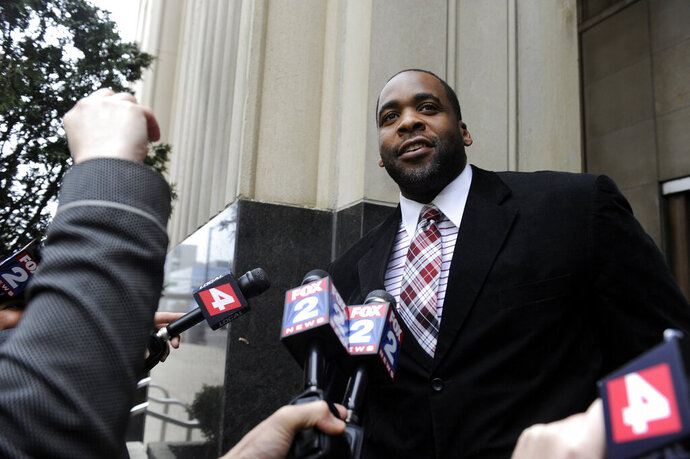 FILE - In this March 11, 2013, file photo, former Detroit Mayor Kwame Kilpatrick leaves federal court after being convicted in Detroit, of corruption charges. Rev. Keyon Payton, A Michigan pastor, says Kilpatrick is being quarantined at a federal prison while awaiting a likely release in June, years before he's scheduled to finish a 28-year sentence for corruption. The U.S. Bureau of Prisons declined to comment about Kilpatrick, saying only that he remains in custody at the prison in Oakdale, La. (David Coates/Detroit News via AP, File)