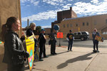Protesters gather outside an annual meeting of the New Mexico Oil and Gas Association to urge more aggressive action against climate pollution in Santa Fe, N.M., Tuesday, Oct. 8, 2019. Inside, New Mexico Gov. Michelle Lujan Grisham praised the oil industry's role in underwriting public education and solicited its help in developing new state regulations for methane emissions, and U.S. Interior Secretary David Bernhardt described federal deregulation efforts. (AP Photo/Morgan Lee)