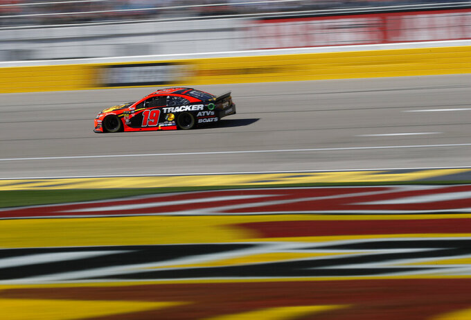 Martin Truex Jr. drives during a NASCAR Cup Series auto race at the Las Vegas Motor Speedway, Sunday, March 3, 2019, in Las Vegas. (AP Photo/John Locher)
