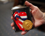 A medal from the 1968 North American Soccer League championship won by the Atlanta Chiefs, is shown Wednesday, Dec. 5, 2018, in Atlanta. Fifty years ago, in a fitting bit of symmetry, an upstart soccer team in a fledgling league gave an up-and-coming city a reason to cheer. The Chiefs won the very first title in the North American Soccer League, beating the San Diego Toros 3-0 before a crowd of about 15,000 at Atlanta Stadium.  (AP Photo/John Bazemore)