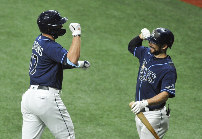 Tampa Bay Rays' Austin Meadows (17) celebrates his solo home run off Boston Red Sox starter Nathan Eovaldi with Brandon Lowe during the first inning of a baseball game Saturday, Sept. 12, 2020, in St. Petersburg, Fla. (AP Photo/Steve Nesius)
