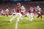 Oklahoma wide receiver CeeDee Lamb (2) runs past teammates and defenders on his way to a touchdown during an NCAA college football game Saturday, Nov. 9, 2019, in Norman, Oka. (Ian Maule/Tulsa World via AP)