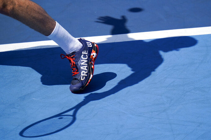 Ugo Humbert, of France, serves to Stefanos Tsitsipas, of Greece, during the third round of the men's tennis competition at the 2020 Summer Olympics, Wednesday, July 28, 2021, in Tokyo, Japan. (AP Photo/Patrick Semansky)