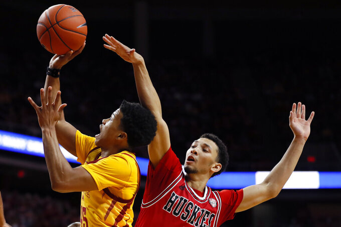 Iowa State guard Rasir Bolton, left, drives to the basket ahead of Northern Illinois guard Trendon Hankerson during the second half of an NCAA college basketball game, Tuesday, Nov. 12, 2019, in Ames, Iowa. Iowa State won 70-52. (AP Photo/Charlie Neibergall)