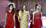 Models wearing face masks pose during a mask fashion show amid the coronavirus pandemic in Seoul, South Korea, Friday, July 24, 2020. (AP Photo/Lee Jin-man)