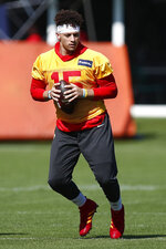 Kansas City Chiefs quarterback Patrick Mahomes (15) runs drills during practice on Wednesday, Jan. 29, 2020, in Davie, Fla., for the NFL Super Bowl 54 football game. (AP Photo/Brynn Anderson)
