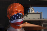 A mannequin wears a face mask at the Citadel Outlets in Commerce, Calif., Thursday, July 2, 2020. California Gov. Gavin Newsom on Thursday urged Californians to turn to their