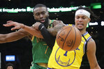 Boston Celtics guard Jaylen Brown, left, and Golden State Warriors guard Damion Lee (1) compete for a loose ball in the second quarter of an NBA basketball game, Thursday, Jan. 30, 2020, in Boston. (AP Photo/Elise Amendola)