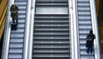 Traveller stay on an empty escalator at the main station in Berlin, Germany, Thursday, Sept. 2, 2021. A nationwide, five-day train strike has brought big parts of the German railway and commuter system to a standstill. (AP Photo/Michael Sohn)