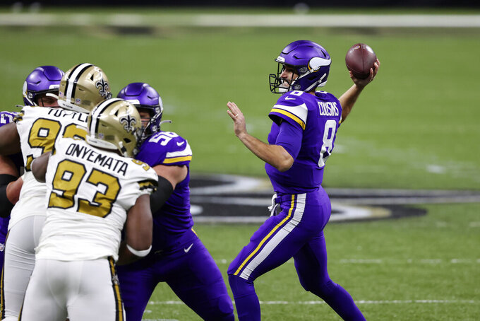 Minnesota Vikings quarterback Kirk Cousins (8) passes in the first half of an NFL football game against the Minnesota Vikings in New Orleans, Friday, Dec. 25, 2020. (AP Photo/Butch Dill)