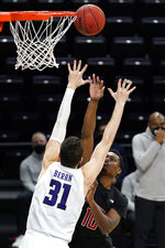 Rutgers guard Montez Mathis, right, shoots against Northwestern forward Robbie Beran during the first half of an NCAA college basketball game in Evanston, Ill., Sunday, Jan. 31, 2021. (AP Photo/Nam Y. Huh)