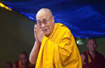 FILE - In this May 27, 2015 file photo, Tibetan spiritual leader the Dalai Lama greets devotees as he arrives to give a religious talk at the Tibetan Children's Village School in Dharmsala, India. Penpa Tsering, new president of the Tibetan exile government said on Thursday, June 17, 2021, he will do his best to resume a dialogue with China after more than a decade, and that a visit by the Dalai Lama to Tibet could be the best step forward. (AP Photo/Ashwini Bhatia, File)