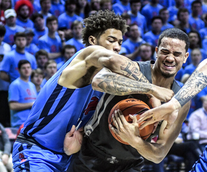 Iowa State guard Nick Weiler-Babb, right, is fouled by Mississippi forward KJ Buffen (14) during an NCAA college basketball game Saturday, Jan. 26, 2019, in Oxford, Miss. (Bruce Newman/Star-Telegram via AP)