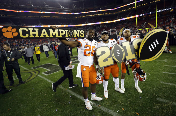 Clemson players celebrate after the NCAA college football playoff championship game against Alabama, Monday, Jan. 7, 2019, in Santa Clara, Calif. Clemson beat Alabama 44-16. (AP Photo/David J. Phillip)