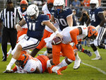 Connecticut quarterback Jack Zergiotis (11) fumbles the ball as he is taken down by Illinois defensive lineman Jamal Woods (91) during the second half of an NCAA college football game, Saturday, Sept. 7, 2019, in East Hartford, Conn. Illinois gained possession of the ball on the play. (AP Photo/Jessica Hill)