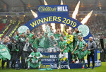 Celtic celebrate with the trophy after winning the Scottish Cup Final at Hampden Park, Glasgow, Scotland, Saturday, May 25, 2019. Celtic wrapped up a domestic treble for an unprecedented third straight season after beating Hearts 2-1 in the Scottish Cup Final on Saturday. Having already won the Scottish League Cup and league titles, Celtic rallied at Hampden Park with a brace from striker Odsonne Edouard. (Jeff Holmes/PA via AP)