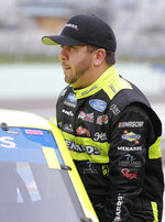 Matt Crafton gets in his truck before practice for a NASCAR Truck Series auto race on Friday, Nov. 15, 2019, at Homestead-Miami Speedway in Homestead, Fla. Crafton is one of four drivers racing for the series championship. (AP Photo/Terry Renna)