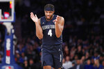 Georgetown guard Jagan Mosely (4) applauds his teammates during the second half of the first round of the 2K Empire Classic NCAA college basketball tournament against Texas, Thursday, Nov. 21, 2019, in New York. Georgetown defeated Texas 82-66. (AP Photo/Kathy Willens)