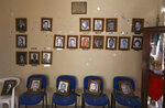 Portraits of former mayors hang on a City Hall wall riddled with bullet holes after a gun battle, in Villa Union, Mexico, Monday, Dec. 2, 2019. Dozens of pickup trucks crowded with armed men and mounted machine guns roared into Villa Union on Saturday. What followed were hours-long gun battles between a cartel force and state police that left 23 people dead. (AP Photo/Eduardo Verdugo)
