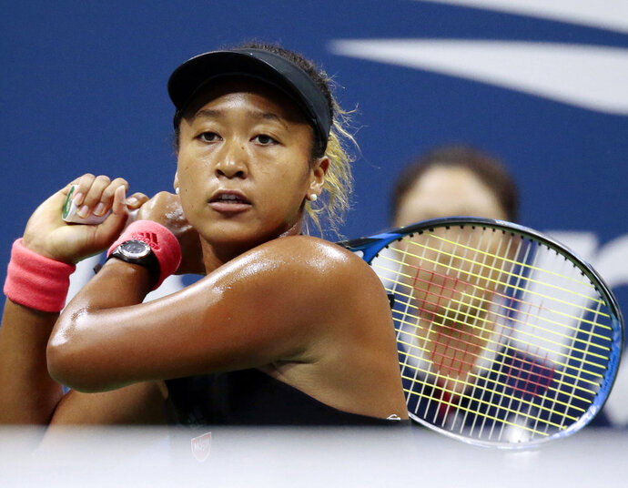 FILE - In this Sept. 8, 2018, file photo, Naomi Osaka, of Japan, returns a shot to Serena Williams fo the U.S. during the women's final of the U.S. Open tennis tournament, in New York. Osaka is headed for big money with both Japanese and global appeal. Among companies vying to cash in on her stardom is Tokyo-based Citizen Watch Co. Its 80,000 yen ($700) Naomi Osaka watch is selling out after it got a lot of exposure on her wrist at the U.S. Open, where she beat Williams. (AP Photo/Andres Kudacki, File)