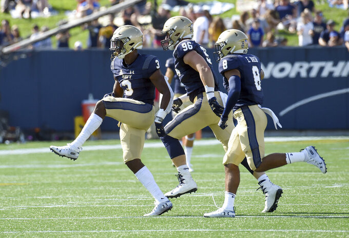 Navy rolls past Holy Cross 45-7 in opener