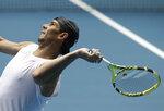 Spain's Rafael Nadal serves during a practice session on Rod Laver Arena ahead of the Australian Open tennis championship in Melbourne, Australia, Thursday, Jan. 16, 2020. (AP Photo/Mark Baker)