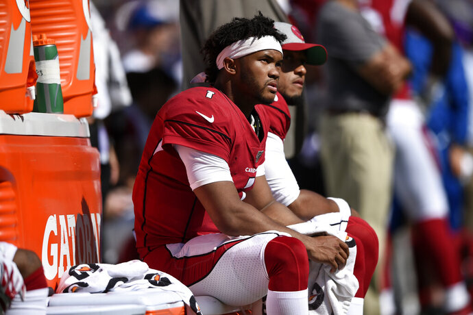 Arizona Cardinals quarterback Kyler Murray sits on the Cardinals sideline in the second half of an NFL football game against the Baltimore Ravens, Sunday, Sept. 15, 2019, in Baltimore. (AP Photo/Gail Burton)