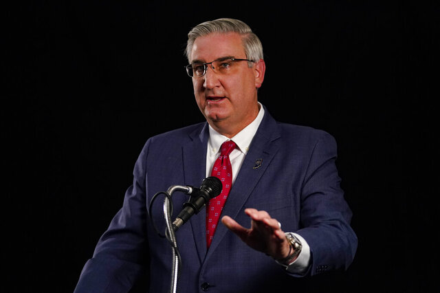 Indiana Republican Gov. Eric Holcomb participates in the Indiana Gubernatorial debate with Democrat Woody Myers and Libertarian Donald Rainwater, Tuesday, Oct. 20, 2020, in Indianapolis. The candidates were in separate studios to allow for social distancing guidelines. (AP Photo/Darron Cummings)