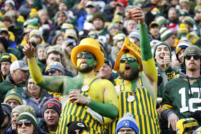 Fans cheer at Lambeau Field during the first half of an NFL football game between the Green Bay Packers and the Washington Redskins Sunday, Dec. 8, 2019, in Green Bay, Wis. (AP Photo/Mike Roemer)